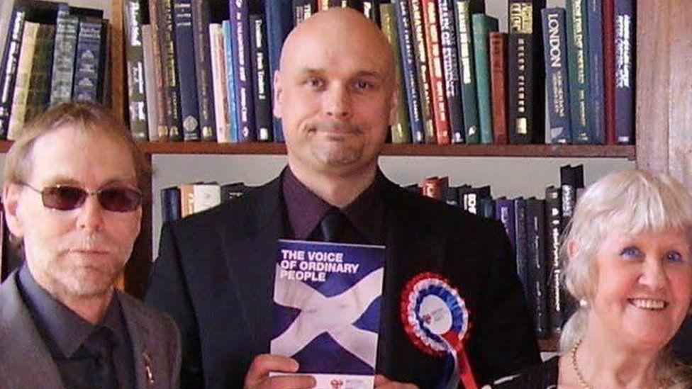 Stephen Goldsack holding BNP manifesto