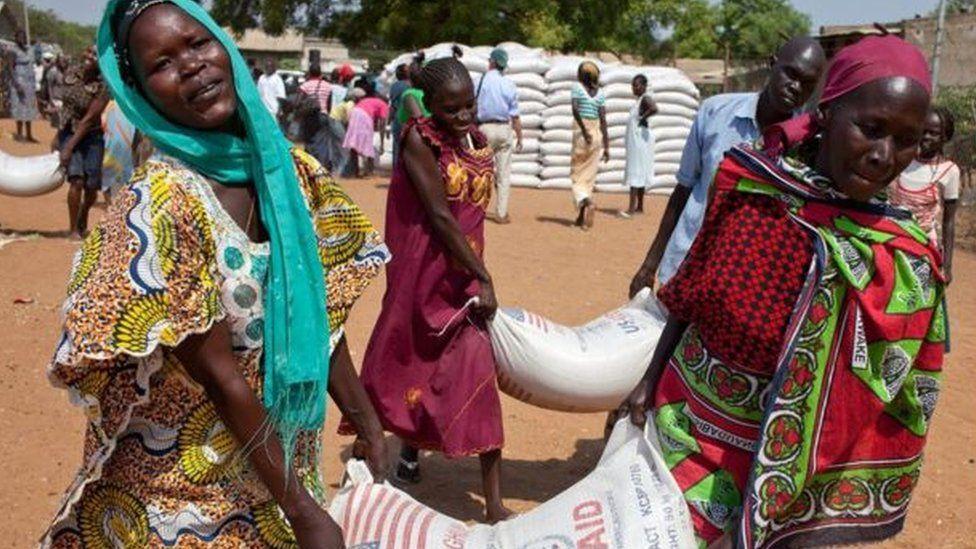 Women in South Sudan receive food aid