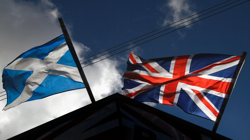 A saltire flag and Union Jack flutter in the wind on March 9, 2017 i