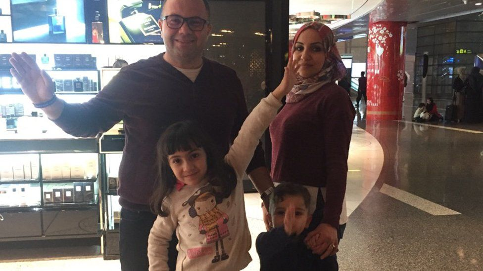 Munther and family in airport in Doha