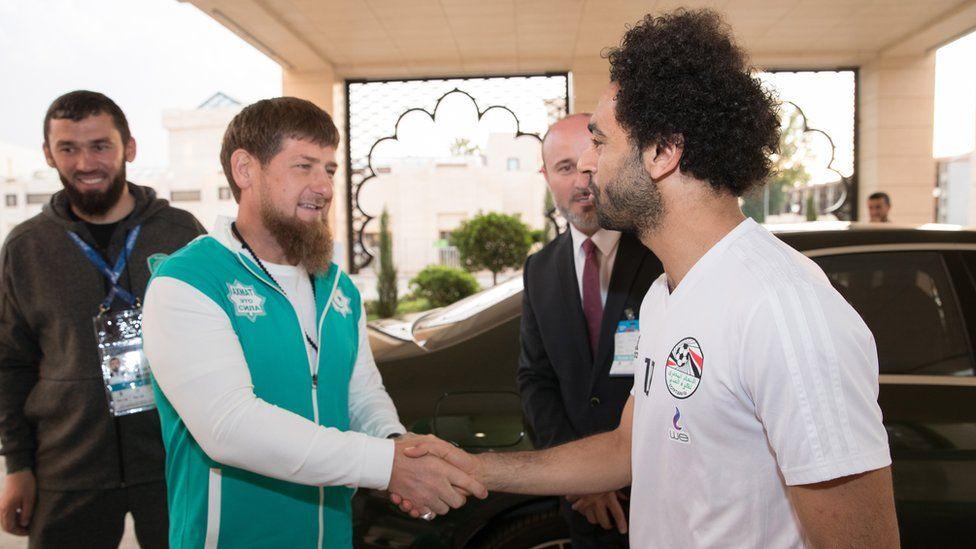 Chechen leader Ramzan Kadyrov (L) shakes hands with Egyptian national soccer team striker Mohamed Salah (R)