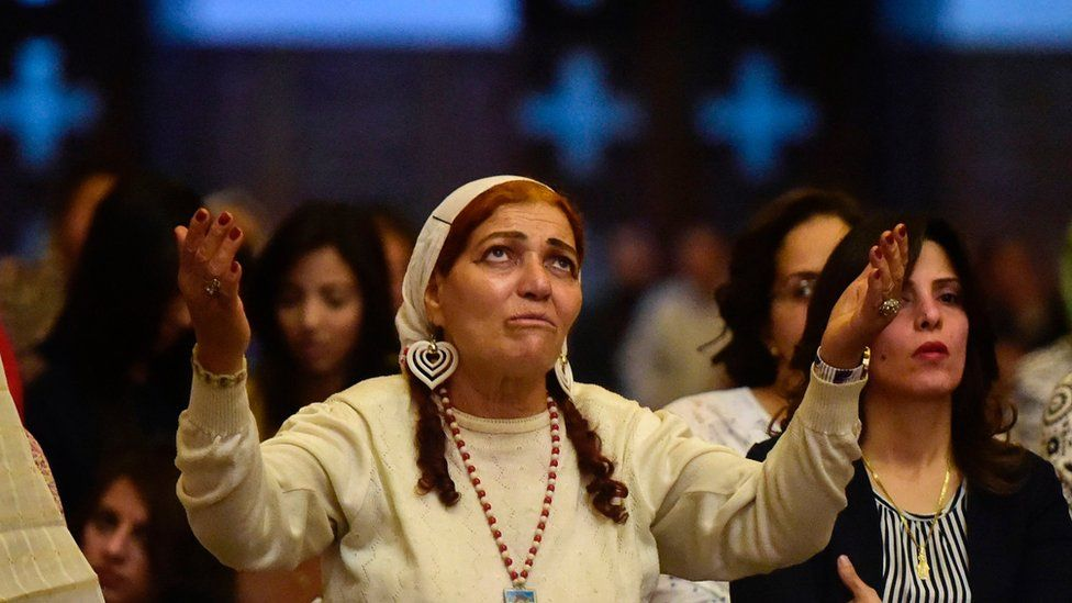 "Egyptian women takes part in an Easter mass led by of Egypt""s Coptic Christian, Pope Tawadros II at the Saint Mark""s Coptic Cathedral, in Cairo""s al-Abbassiya district late on April 15, 2017"