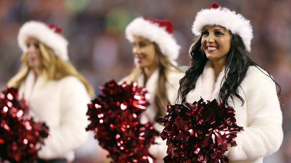 NFL cheerleaders in Christmas costumes