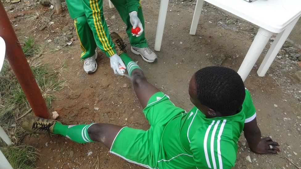 A former Boko Haram member being treated at a football training session in Nigeria