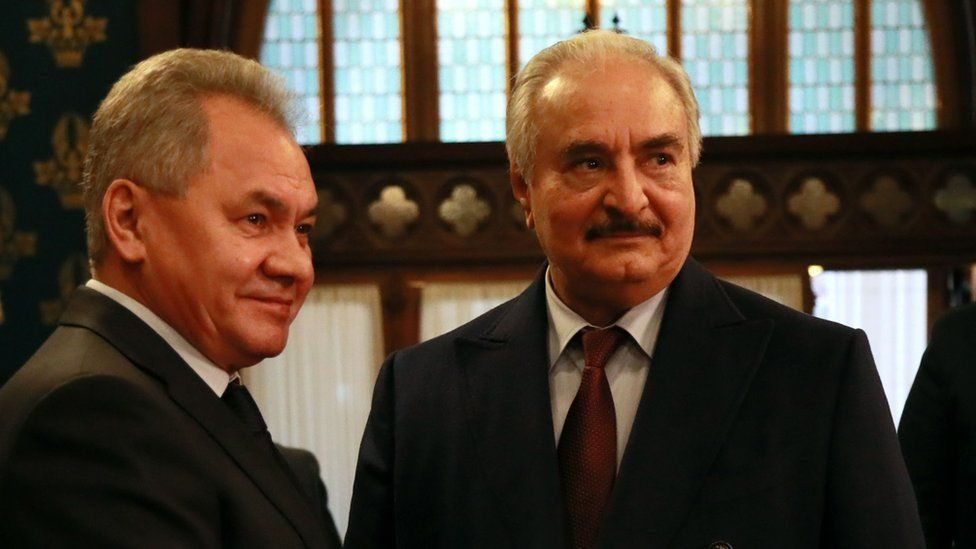 Khalifa Haftar shakes hands with Russian Defence Minister Sergei Shoigu in Moscow