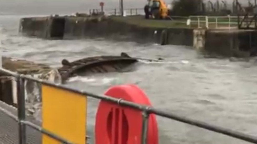 Picture of a section of the lock gates at Milford Marina floating in the water after they were forced open