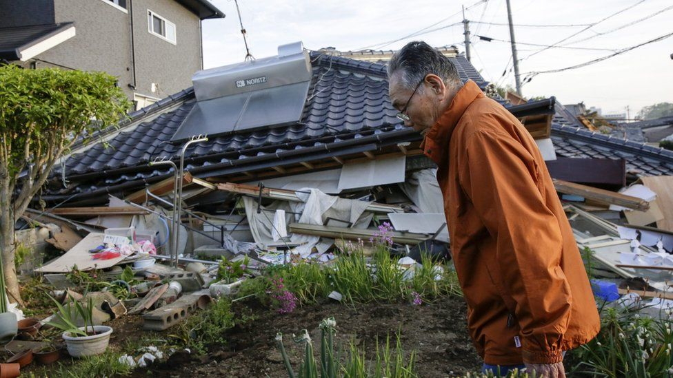 A resident outside his house collapsed in Mashiki, Kumamoto Prefecture, south-western Japan (16 April 2016)