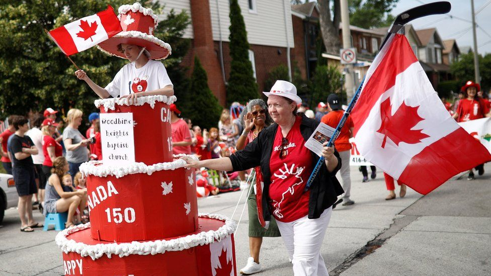 """People participate in the East York Toronto Canada Day parade, as the country marks its 150th anniversary with """"Canada 150"""" celebrations, in Toronto, Ontario"""
