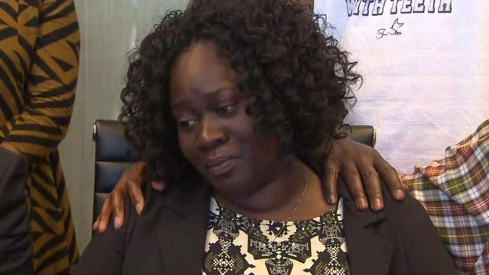 Jordan's mother, Charmaine, silently wept as her lawyers called for the officer's arrest