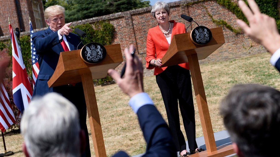 """US President Donald Trump (L) and Britain""""s Prime Minister Theresa May hold a joint press conference following their meeting at Chequers, the prime minister""""s country residence, near Ellesborough, northwest of London on July 13, 2018 on the second day of Trump""""s UK visit."""
