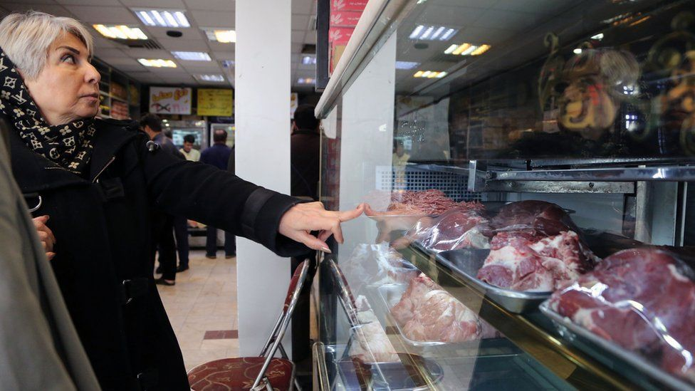 An Iranian woman buys meat a butcher's shop in Tehran (12 February 2019)