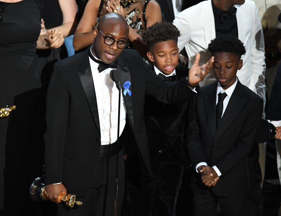 Writer and director Barry Jenkins with actors Jaden Piner (centre) and Alex R Hibbert (right)