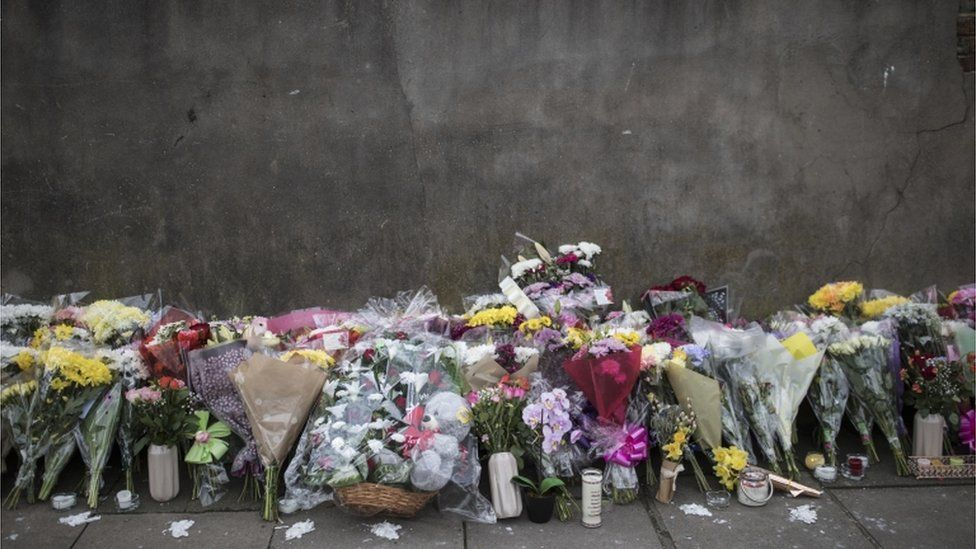 Flowers at the scene of a shooting in Tottenham