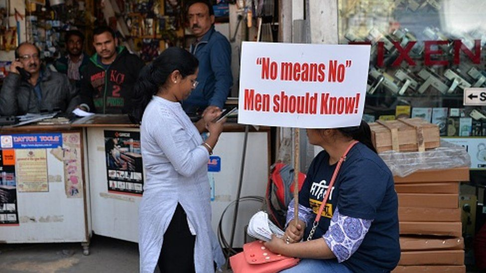 A Woman holds a placard during a protest against rape and violence against women in New Delhi on March 6, 2019