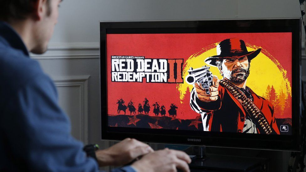A main plays Red Dead Redemption on his games console