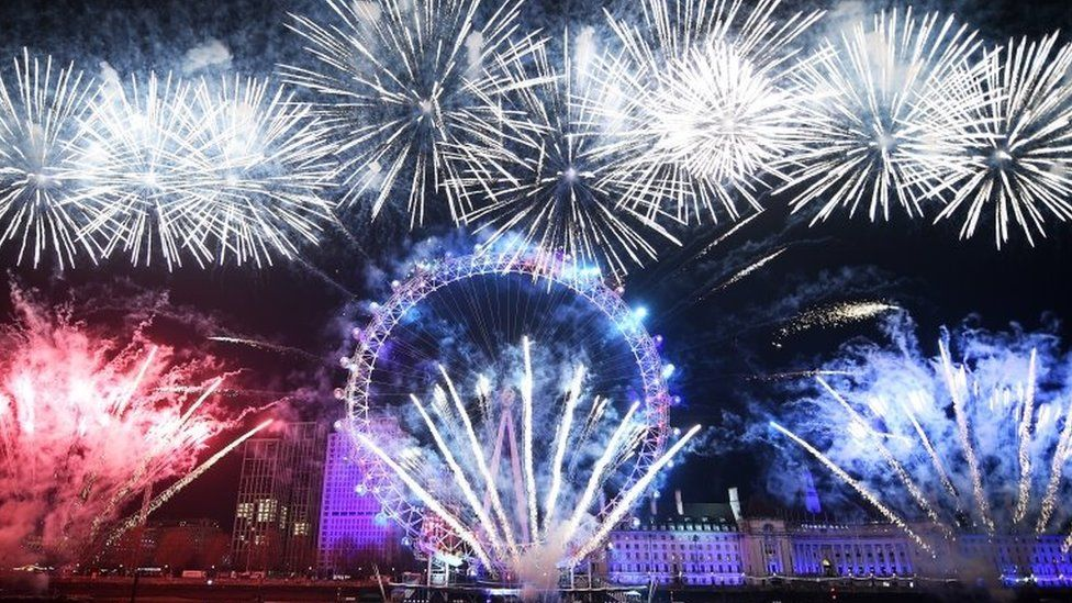 Fireworks explode around the London Eye during New Year 2020 celebrations