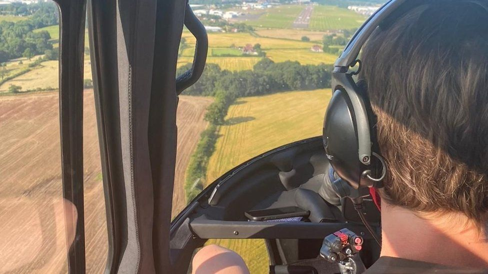 Child flying in the helicopter