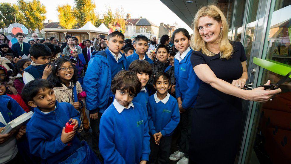 Cressida Cowell and school children