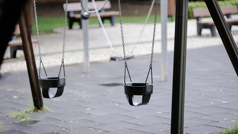 Swings in an empty playground in Romania