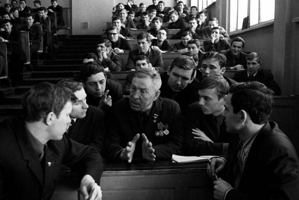 Alexei Stakhanov talking to enraptured students