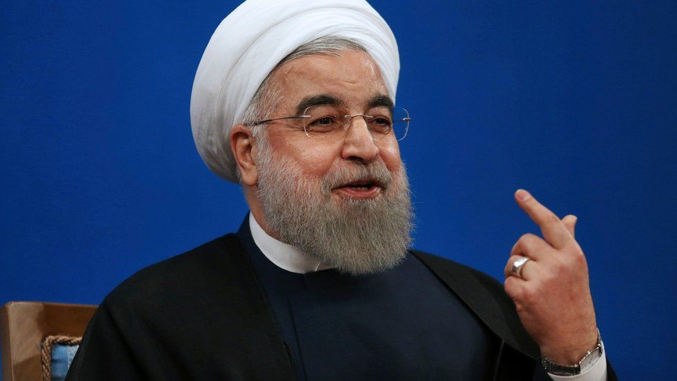 Iranian President Hassan Rouhani gestures as he speaks to reporters in Tehran (17 January 2017)