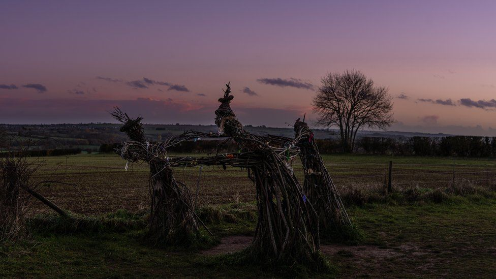 """""""Three dancing fairies"""" sculpture at the Rollright Stones near Chipping Norton"""
