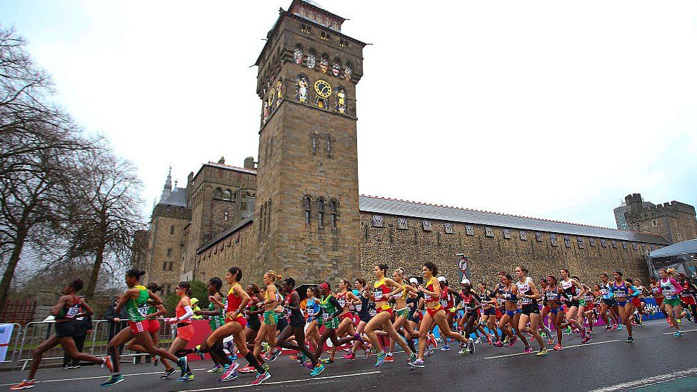 Runners running past Cardiff Castle