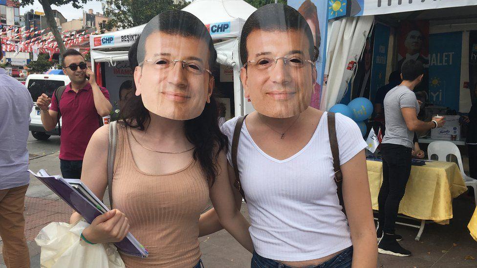 Two women wearing Imamoglu masks