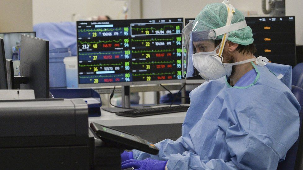 Medical staff at a newly set up intensive care unit in the Poliambilanza hospital in Brescia, Italy, 30 March 2020