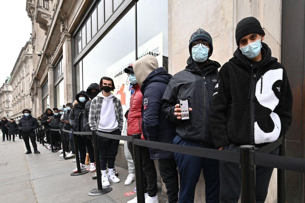 Shoppers queue outside a Nike store in central London