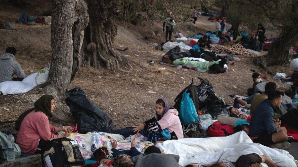 Migrants sleeping in woods after fleeing Moria camp, 10 Sep 20