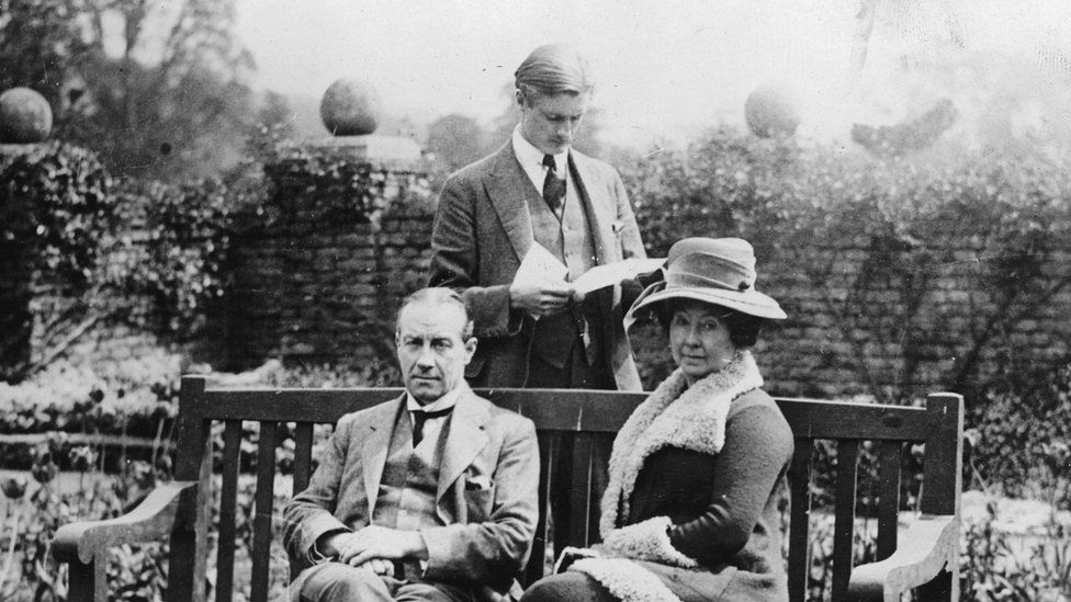 British Prime Minister Stanley Baldwin and his wife Lucy and his son Oliver in the garden of the summer residence at Chequers. About 1936.