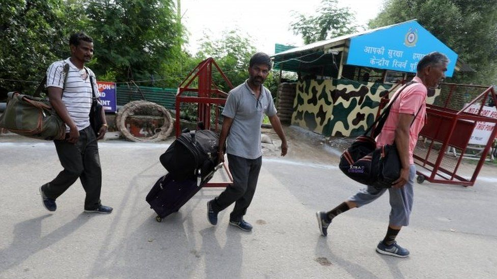 Tourists leave from Amarnath base camp after the pilgrimage was suspended