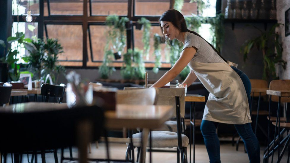 woman cleaning tables