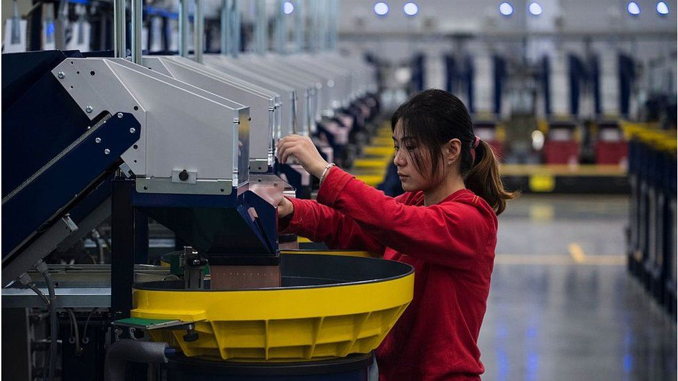 A woman works at a Lego factory in Jiaxing, China