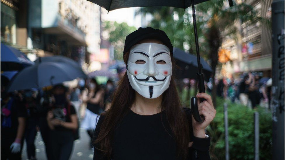 In this picture taken on October 1, 2019, a protester wears a Guy Fawkes mask to cover her face, popularised by the V For Vendetta comic book film, in Hong Kong