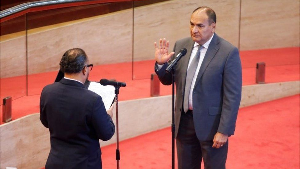 President of El Salvador's Congress, Ernesto Castro, swears in the new president of the Supreme Court, Oscar Lopez Jerez, as the congress removed the Supreme Court judges, at the Salvadoran congress, in San Salvador, El Salvador, May 1, 2021