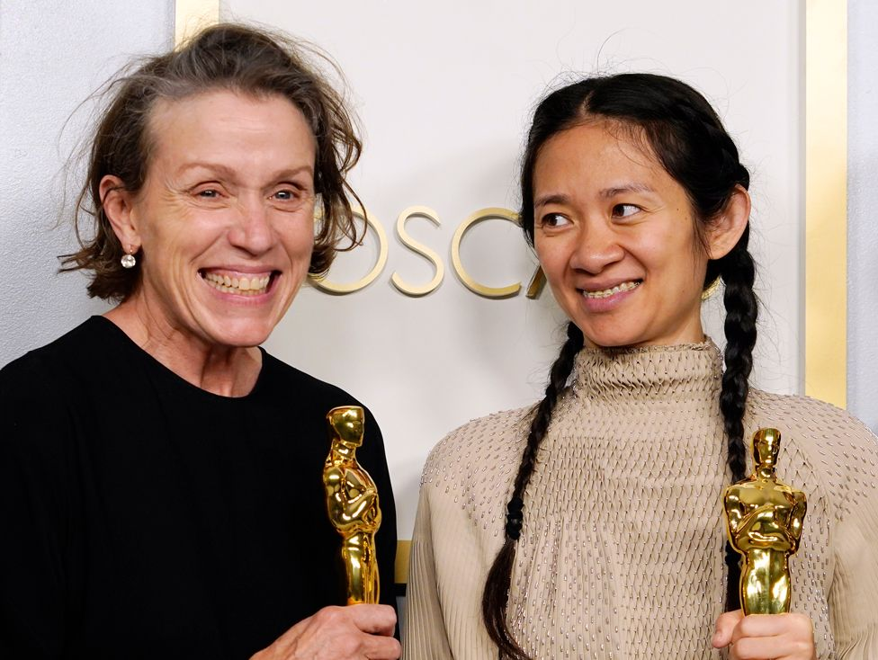 Frances McDormand and Chloe Zhao pose in the press room at the Oscars on 25 April 2021, in Los Angeles