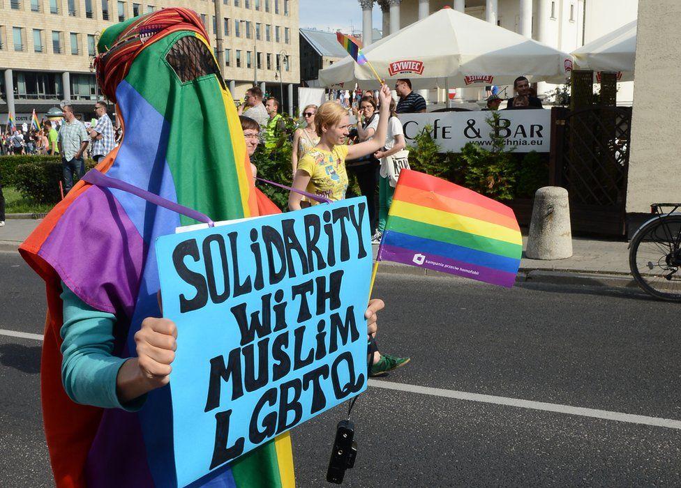Protester wears rainbow burka in solidarity with Muslim LGBT people, Warsaw 2003
