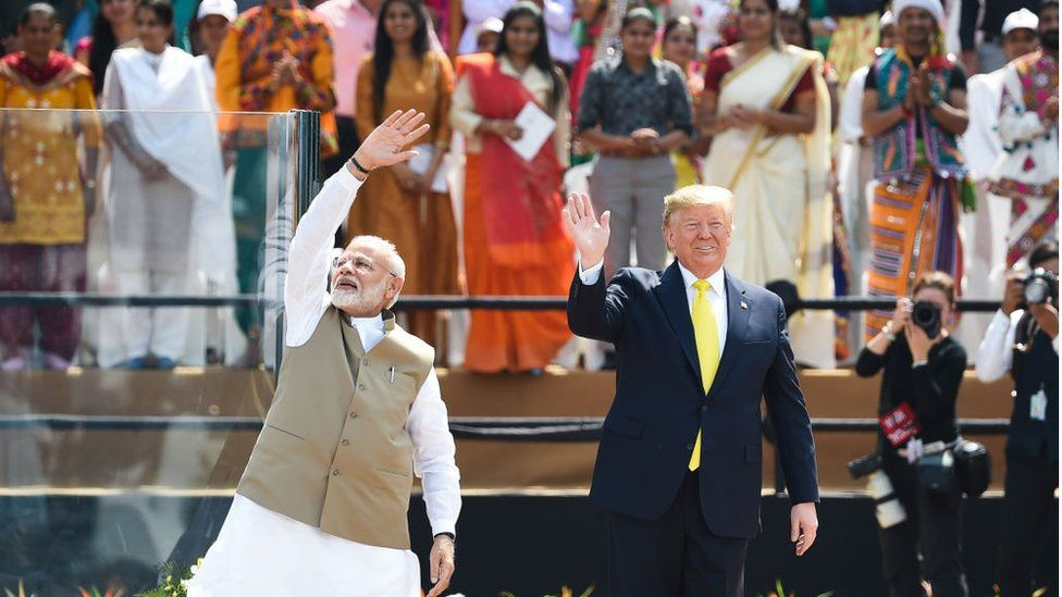 Narendra Modi and Donald Trump wave to the crowd