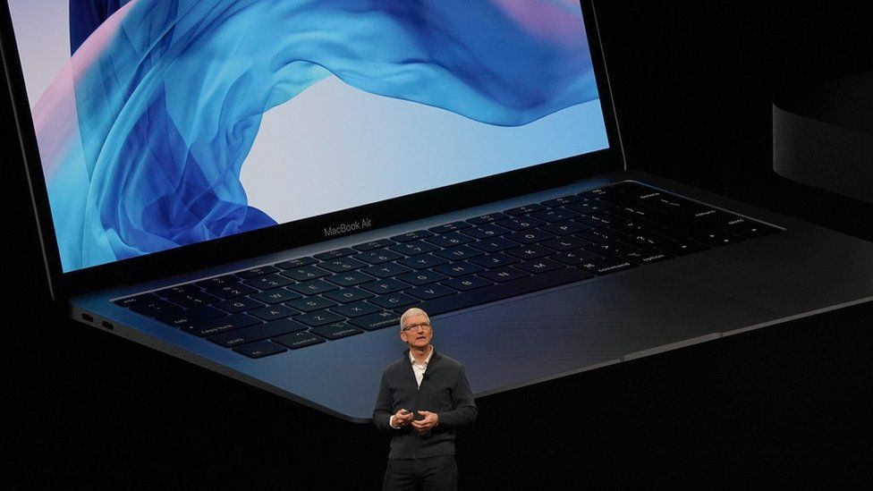 In this file photo taken on October 30, 2018 Apple CEO Tim Cook presents new products, including new Macbook laptops, during a special event at the Brooklyn Academy of Music, Howard Gilman Opera House n New York.