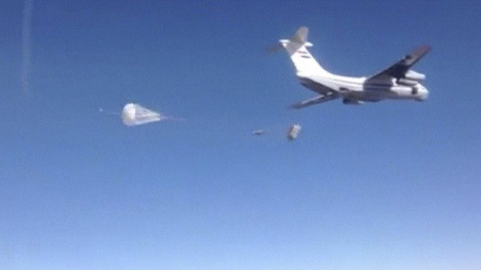 A Russian air force cargo plane drops off humanitarian aid in the region around the eastern Syrian city of Deir al-Zour, which is besieged by Islamic State militants, according to Russia's Defence Ministry, in this still image taken from video footage released by the ministry on January 15, 2016