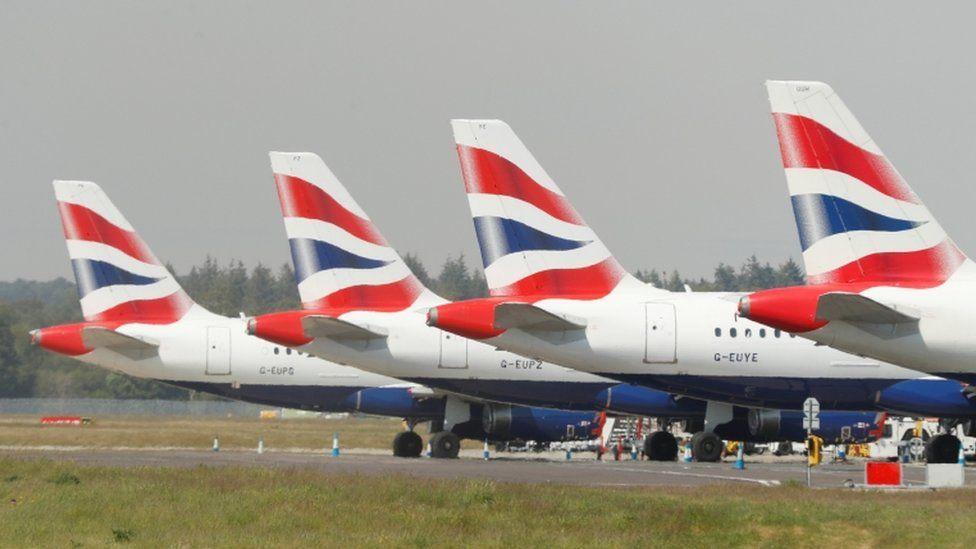 BA planes sitting on a runway