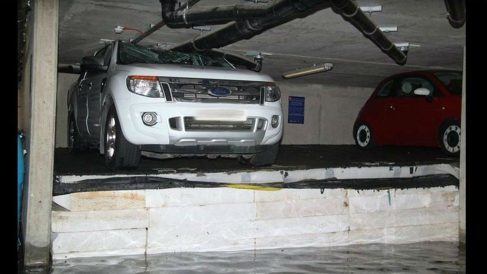 Car crushed by wet insulation