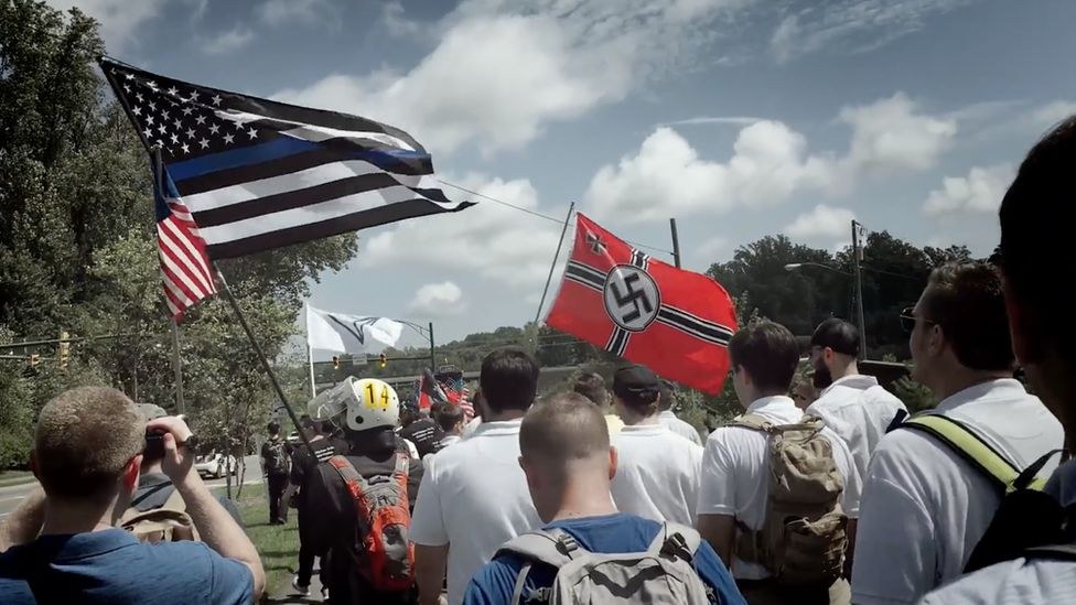Marchers carrying nazi and US flags. A march in Charlottesville which Patrik Hermansson participated in while undercover