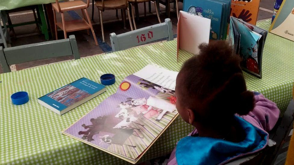 A child reading at the Cafemin migrant centre in Mexico City