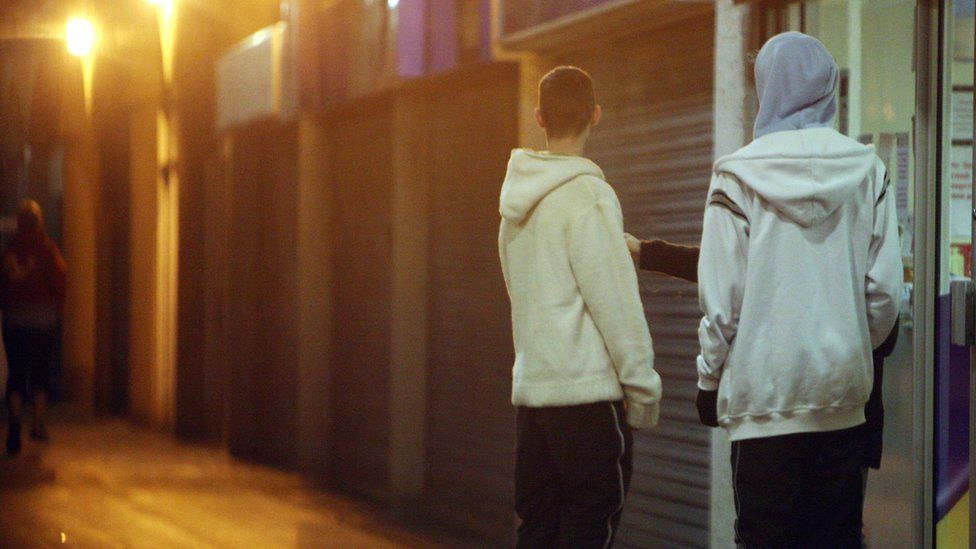 Young people in hooded tops on a housing estate east of Bristol city centre