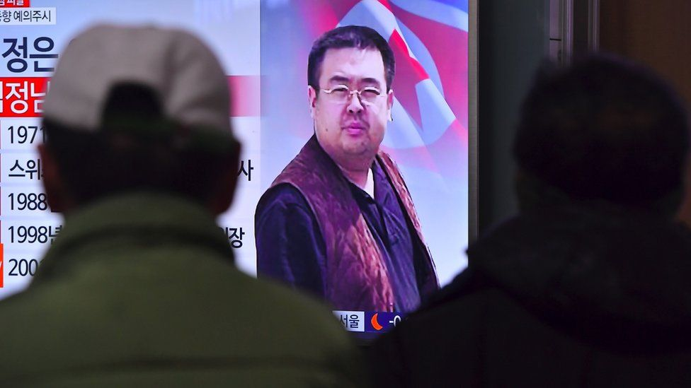 People watch a television showing news reports of Kim Jong-Nam, the half-brother of North Korean leader Kim Jong-Un, at a railway station in Seoul o
