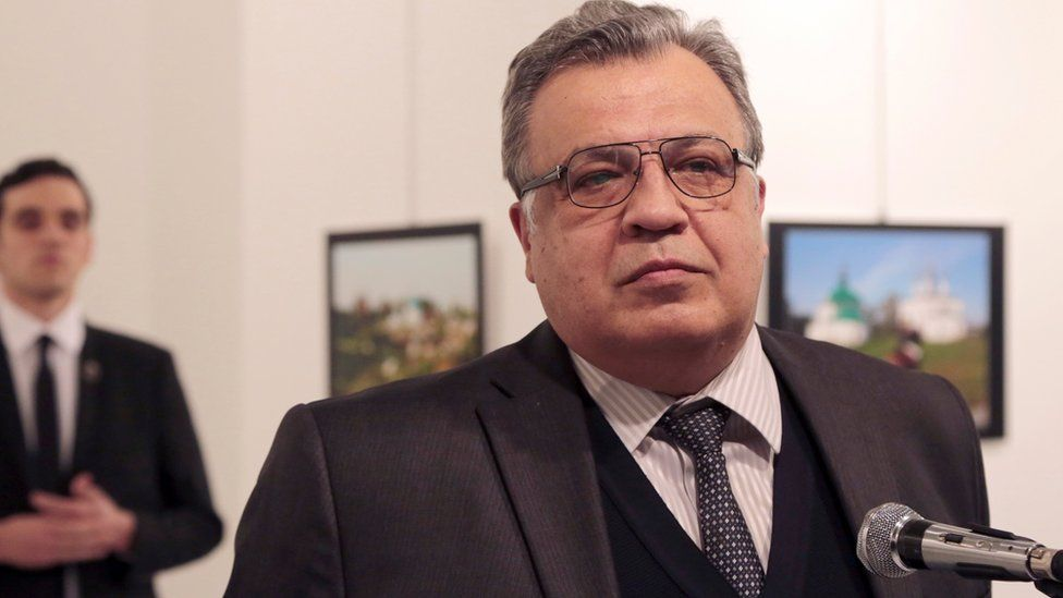 The gunman named as Mevlut Mert Altintas is pictured behind Andrei Karlov, Russian ambassador to Turkey, moments before he shot him dead in the back on 19 December 2016