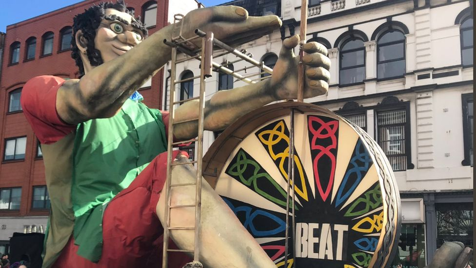A giant bodhrán player was part of Belfast's St Patrick's day parade